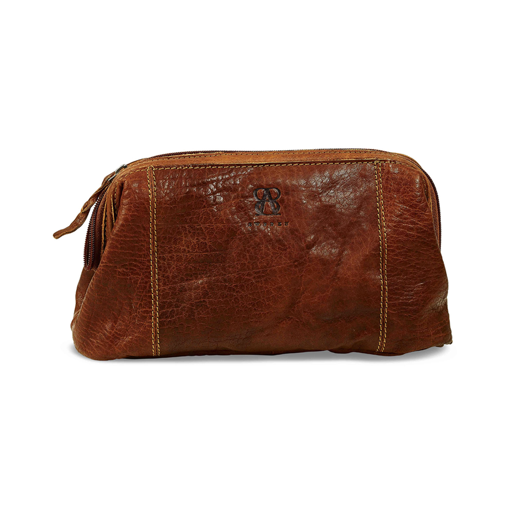 Exclusive toiletry bag in waxed buffalo leather. Lining in cotton, 6 compartments Delivered packed in a fine cloth bag